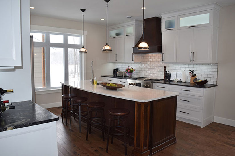White kitchen cabinets with stained island for Bruce kitchen cabinets
